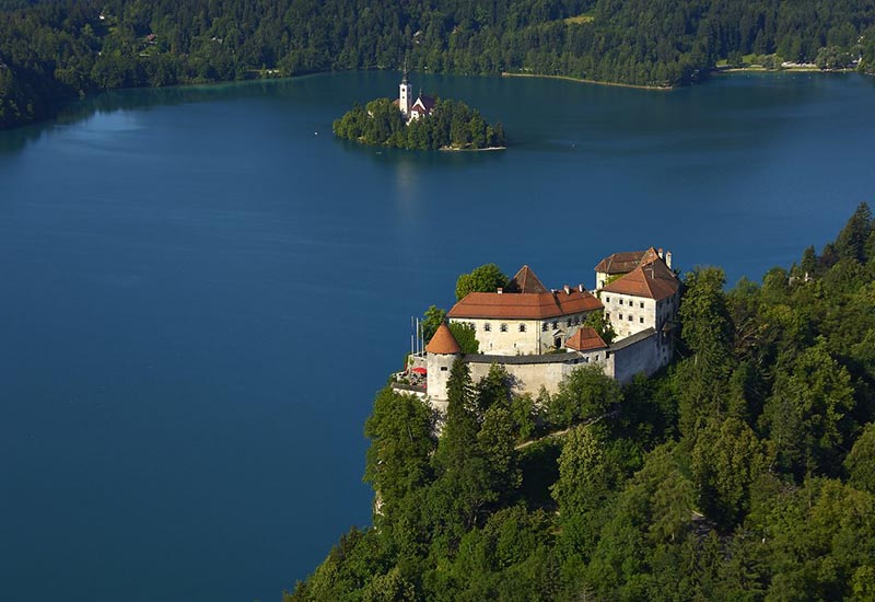 Drone photo of Bled's castle and islet with a church