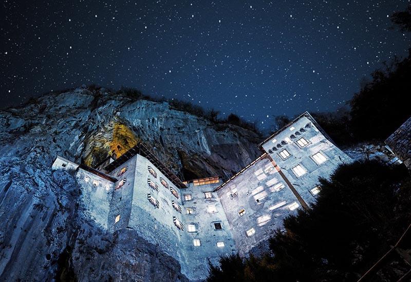 Predjama castle after dark